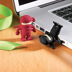 Ninja Flash Drive $24.99  This stealthy ninja is actually a 4 GB USB flash drive in disguise! It packs a lot of punch for storing and sharing photos, videos and music on the go. The playful silicone figure protects the hardware inside and features magnetic hands so you can store the drive on any steel surface.     2.0-1.1 compatible