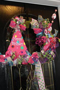 Whimsical birthday wreath, love the hat