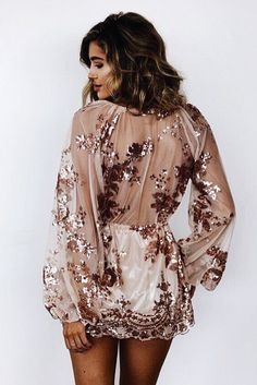 A instant jaw dropper! You'll be sure to catch any and all attention in this sexy sheer sequined dress!