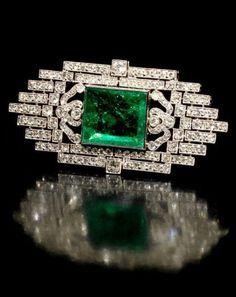 """fawnvelveteen: """"An art deco emerald and diamond brooch, circa 1925 """""""