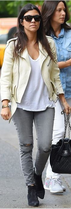 Kourtney Kardashian: Sunglasses, jacket, and shoes – Saint Laurent  Bracelet – Cartier  Purse – Chanel  Jeans – J Brand