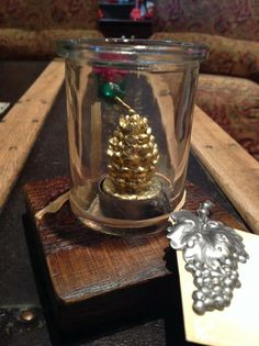 Little wine stave and recycled wine bottle candle sets.  Perfect little gift at Market Alley Wines.