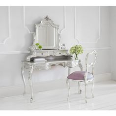 Sylvia Silver Grande Dressing Table. Pure glamour in your romantic French bedroom. Metallic silver dressing table.
