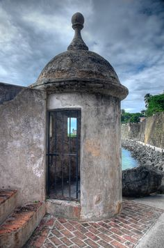 *PUERTO RICO ~ A guard's post at El Morro Fort in Old San Juan, A Morro is a rocky outcrop in the shallow waters of a harbot, often round in shape + sometimes very high. They are commonly made from hard granite or quartz.