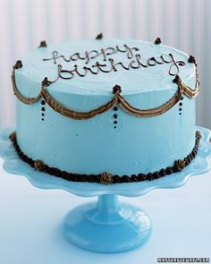 blue birthday cake.  in my mind the inside is dark chocolate with chocolate mousse in between the layers.