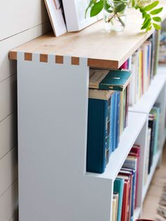 interlocking white and blonde wood sides make for interesting detail in this bookcase | Norrgavel