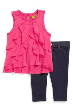 Pair jeggings with this cute pin top for a Spring ensemble!