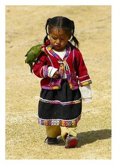 Peruvian girl walking with her pet bird