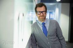 Portrait smiling businessman in office corridor -