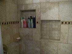 Offset inset shelves in the porcelain tile shower.