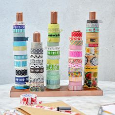 DIY washi tape holder. Make this washi tape / ribbon holder using an old broom handle. Easy project for a great storage solution. Pillarboxblue.com