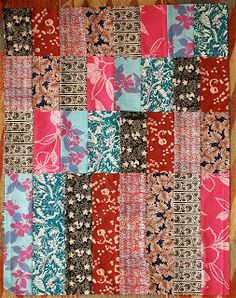 These dual Boston Commons quilt tops were made with the same fabrics in each (the colors are different because the pictures were taken at di...