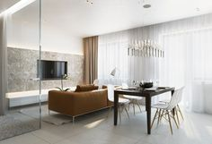 The space here is all about texture from the plush leather sofa to the gauzy white curtains.