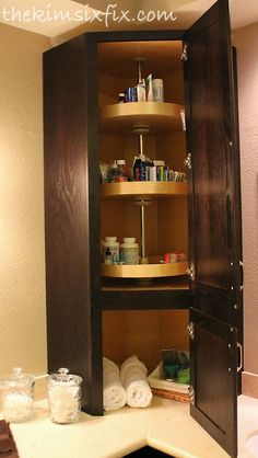 Master Bathroom Remodel: 80s to Awesome .... Love the lazy susan idea for medicine cabinet stuff, no more losing important little items in the back!