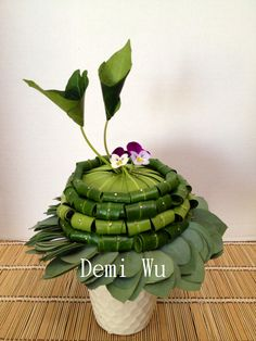 Design by Demi Wu floral design studio using lots of folded leaves