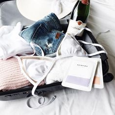 Travel Essentials // Skinfluncer @ whistleandawhim Packed and ready for a warm weather escape ☀️✈️⛱