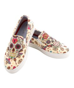 Someone please but these for me!! Look at this #zulilyfind! Ivory Sugar Skulls Slip-On Sneaker by Goby #zulilyfinds