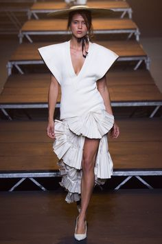 Jacquemes - Simon Porte Jacquemus drew upon the South of France for a collection that included a slim skirt featuring asymmetrical fan pleating that's bound to turn up at destination weddings.
