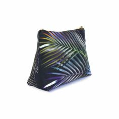 Not your usual make-up bag!  This beautiful navy cosmetics pouch is made from soft eco friendly linen.   Inspired by tropical islands, botanical illustrations and bold confident style, it has palm leaves in shimmering blues, greens and silvers.  #sustainablemakeupbag #makeupbag #veganmakeup Vegan Makeup, Cosmetic Pouch, Botanical Illustration, Sustainability, Vibrant, Tropical, Cosmetics, How To Make, Bags