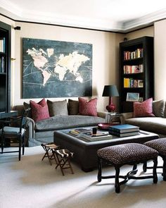 Fashionable living room with leopard-print footstools and mixed media map art (via sapphire blue living room decor…. «eclectic revisited by Maureen Bower)