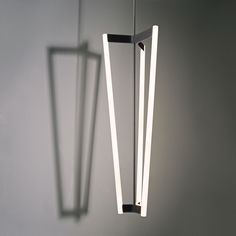 With its four rods, the Tube Chandelier casts a striking shadow when lit. Available in either satin brass or black plated stainless steel. Lighting Designer We Love: Michael Anastassiades by Eujin Rhee. Browse inspirational photos of modern homes. Cool Lighting, Modern Lighting, Lighting Design, Pendant Lighting, Modern Chandelier, Brass Chandelier, Blitz Design, String Lights, Ceiling Lights