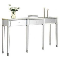 """Three-drawer sofa table covered with mirror panels and silver leaf.   Product: Sofa tableConstruction Material: Birch, MDF, mirrored glass and crystalColor: SilverFeatures: Silver leaf platingDimensions: 37"""" H x 70"""" W x 15"""" D"""