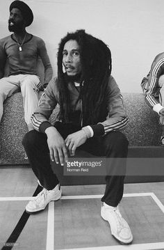 Jamaican singer-songwriter Bob Marley (1945 - 1981) takes a break during a football match against a team led by fellow reggae artist Eddy Grant, Marley's freind Derek Donaldson sits behind, Hammersmith Leisure Centre, London, 16th July 1980.