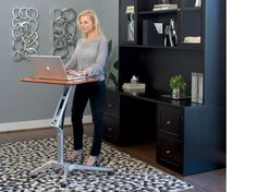 Dania - Ergonomically designed as a mobile freestanding desk for the home or the office. Moves silently up and down in seconds, featuring a counter-balance mechanism to enable immediate and effortless, height adjustment so you can work sitting or standing. Available with a cherry or venge melamine top and a grey metal base on castors.Height extends from 28