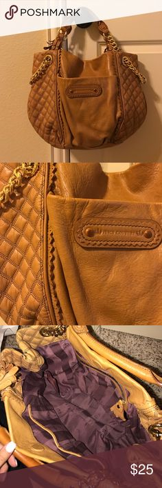 Juicy Couture brown leather purse Brown leather medium sized juicy Couture purse with gold accents and purple interior. Great condition Juicy Couture Bags Shoulder Bags