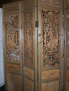 Four panel wood room divider screen.  Hand carved.  A rare and unique piece.