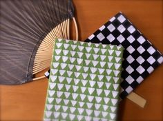 Tenugui towels and a paper fan for a summer festival at night.