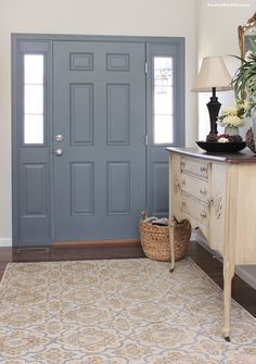 Entryway makeover! A fresh coat of paint for the front door and some vintage antique furniture, perfection!