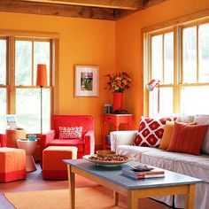 This room would be in my dream house because I love the warm, inviting colors. Es specially the orange on the walls! I try to put a little red in every room to give it a little pop. This room has the perfect amount of red.