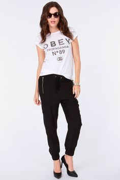 The Addicted to Love Black Harem Pants boast an elasticized banded waist and a decorative tie, plus elasticized cuffs for a perfectly cropped fit. Yoga Harem Pants, Black Harem Pants, Harem Trousers, Addicted To Love, Casual Summer Outfits, Joggers, Capri Pants, Stylish, My Style