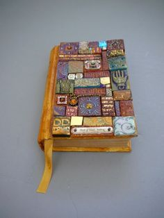 Cover made using polymer clay...also textured backgrounds using puffy paint and paint or metallic papers