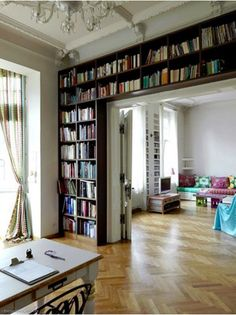 Bookcases over doors on wall #bookshelf #library #roomwithbooks