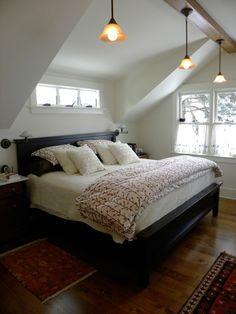 shed dormer inside bedroom, small windows above bed
