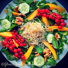 mango salad with red berries, cucumber, sprouts, walnuts and olive oil