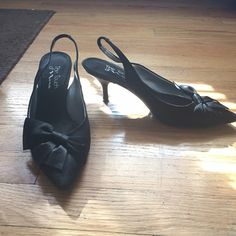 Gorgeous Black Bow Heels w/ Strap Gorgeous black bow heels! Size 7.5. Strap in the back for your ankle. Pointed toe. Short heel. Is a little dirty underneath, but WILL be cleaned at purchase. Adorable for work or events! Shoes Heels