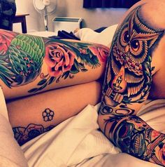 Colorful tattooed couple, owl and roses