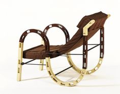 """Chair / Eileen Gray / 1938 / France / """"The canvas seat is suspended in an S-bend of perforated, laminated wood, and the chair can be folded to half-size for storage"""" -- V and A Museum"""