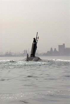 BAHRAIN (March 21, 2009) The Los Angeles-class attack submarine USS Hartford (SSN 768) pulls into Mina Salman pier in Bahrain where U.S. Navy engineers and inspection teams will assess and evaluate damage that resulted from a collision with the amphibious transport dock ship USS New Orleans (LPD 18) in the Strait of Hormuz March 20. Overall damage to both ships is being evaluated. The incident remains under investigation.
