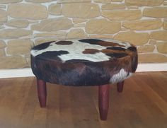 round cowhide footstool ottoman available now