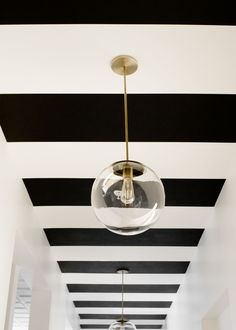 p+p reveal: nashville dentistry co. — Pencil & Paper Co. Black And White Hallway, Striped Hallway, Striped Ceiling, Black And White Wallpaper, Hallway Ceiling, Hallway Paint, Hallways, Cottage Hallway, Wallpaper Ceiling