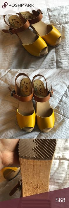 Lotta from Stockholm Clogs Yellow and Brown These are great clogs! They just didn't fit my feet right. These are EU size 36 but I think they're more of a US 6.5 instead of a 6. I bought these and couldn't return them so that's the only reason I'm selling. They are beautiful shoes in excellent condition, just worn around the house a few times. Lotta from Stockholm Shoes Mules & Clogs