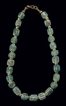 A ROMAN GLASS BEAD NECKLACE CIRCA 200 B.C.-100 A.D.