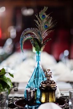 Peacock feather and perfume bottle by Briny