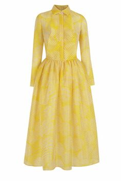 We're swooning over this yellow striped organza shirt dress, in a fit and flare silhouette with ruffles on the chest. Midi length. Hidden front button placket, pointy collar and long cuffed sleeves. Two side pockets. On the runway picture, the model wears a crinoline/petticoat available on demand (contact us by email). The dress is offered with an optional cancan to increase its volume. We love this stunning, feminine dress paired with embellished menswear inspired brogues. Care: Dry clean…
