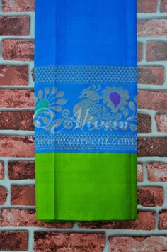 Cerulean Blue Plain Handloom Saree with Broad Green Peacock Kuppadam Border