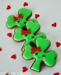 Mr. & Ms. Shamrock Cookies for St. Patrick's Day  from Make Me Cake Me  Couple shamrock cookies using heart springles, pink small rounds and little black dots. sooooo cute!!!    http://www.makemecake.me/2014/03/10/mr-ms-shamrock-cookies-for-st-patricks-day/